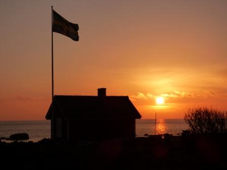 Solnedgång över flaggan.